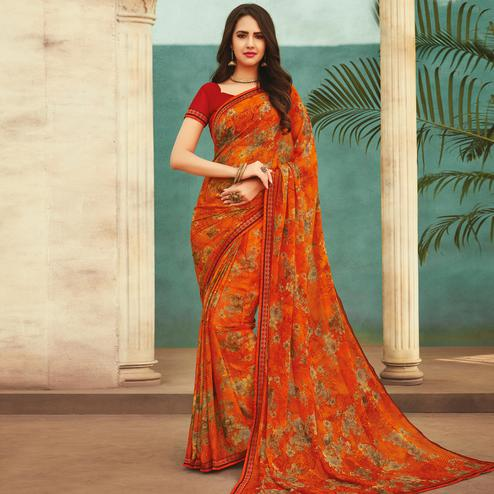 Fantastic Orange Colored Casual Wear Printed Chiffon Saree