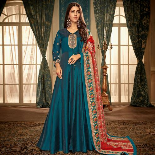 Impressive Teal Blue Colored Partywear Embroidered Heavy Muslin Gown