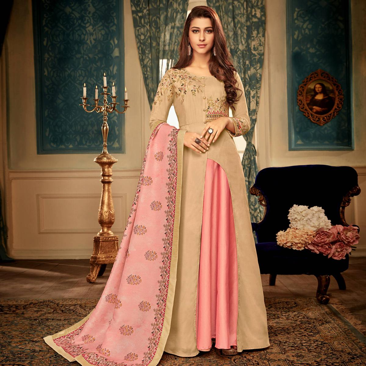 Flattering Beige Colored Partywear Embroidered Heavy Muslin Gown