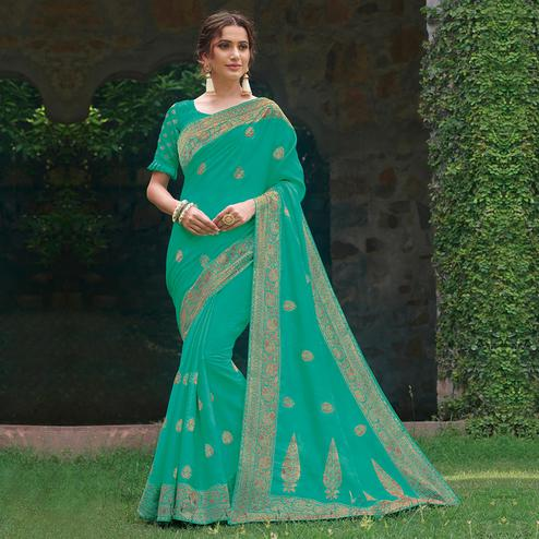 Amazing Rama Green Colored Partywear Floral Embroidered Tussar Silk Saree