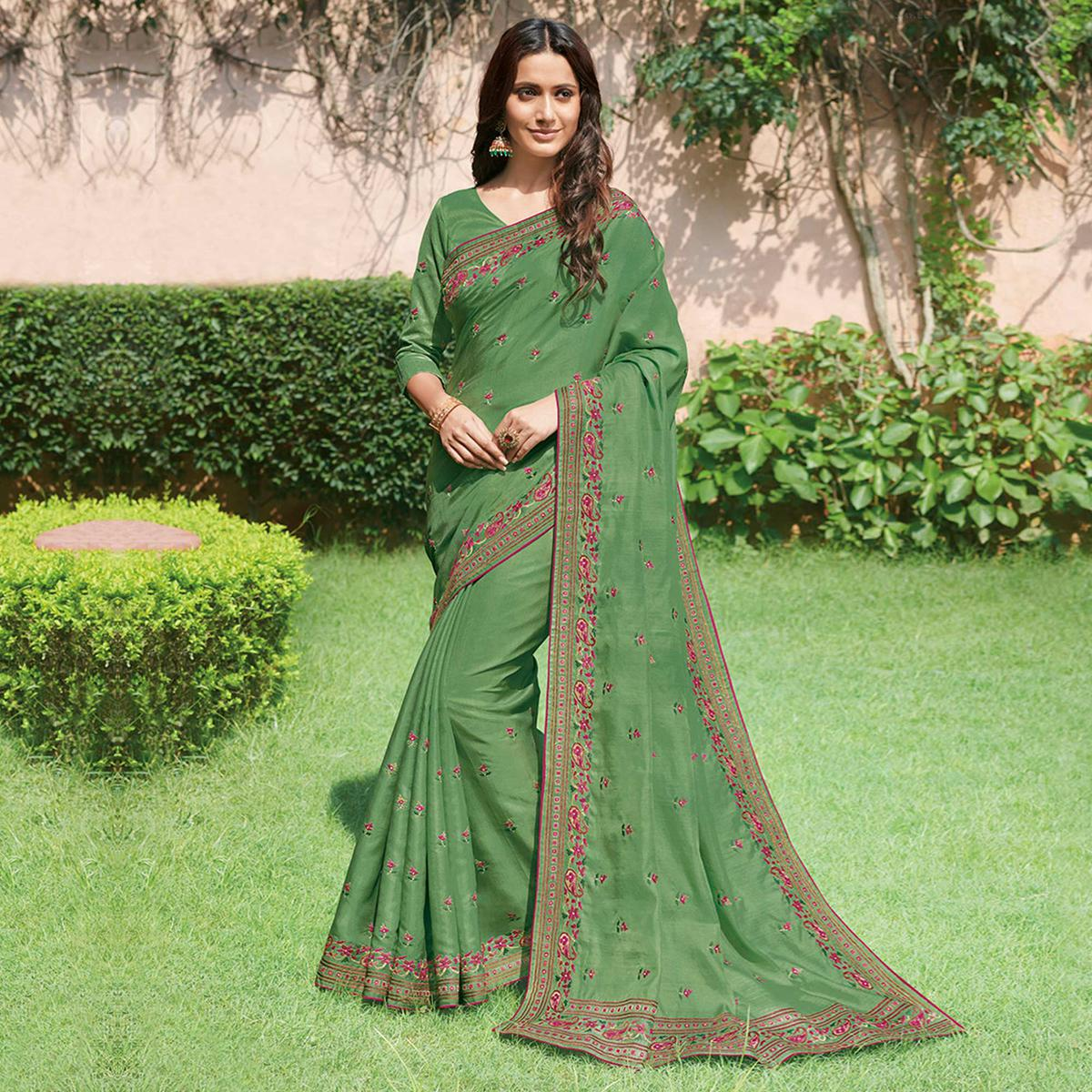 Lovely Green Colored Partywear Floral Butti Embroidered Tussar Silk Saree
