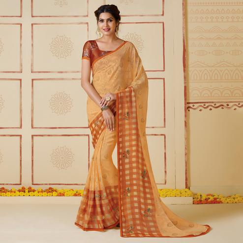 Sophisticated Rust Chikoo Colored Partywear Embroidered Brasso Saree