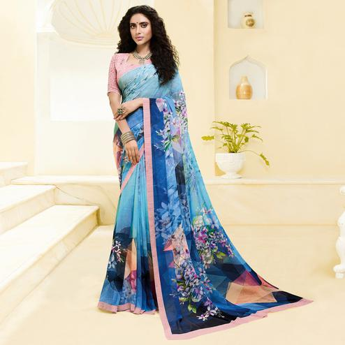 Preferable Blue Colored Casual Wear Floral Printed Georgette Saree