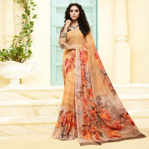 Marvellous Peach Colored Casual Wear Floral Printed Georgette Saree