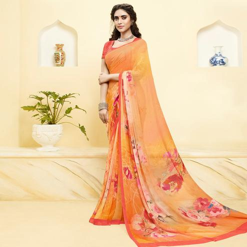Stunning Orange Colored Casual Wear Floral Printed Georgette Saree