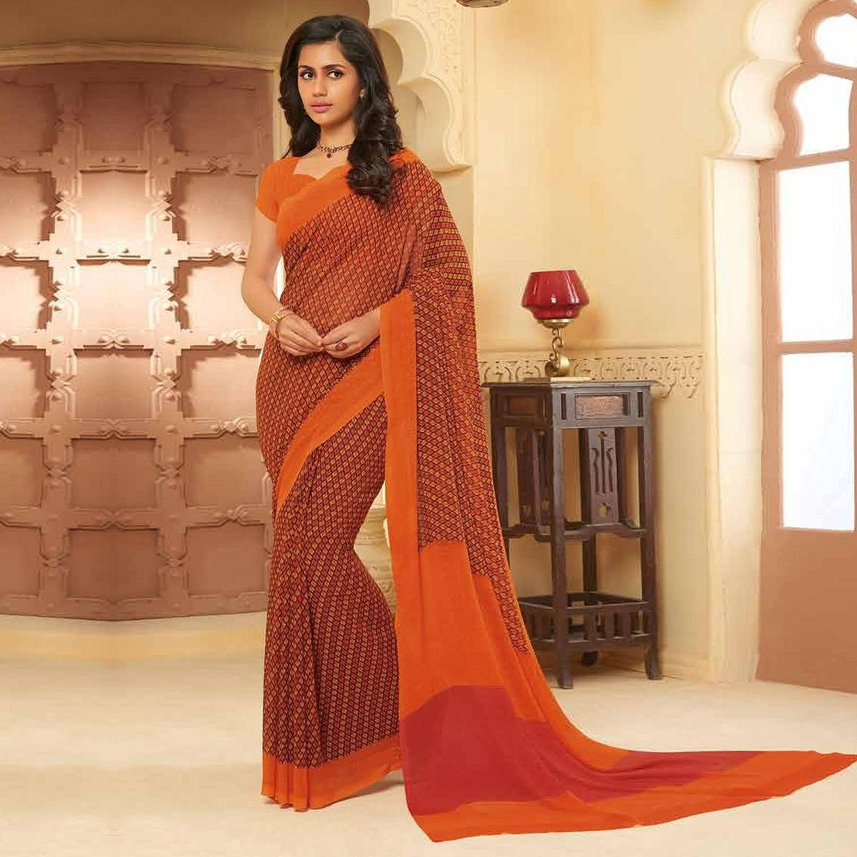 Attractive Rust Colored Casual Wear Printed Georgette Saree