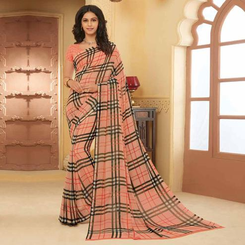 Eye-catching Peach Colored Casual Wear Printed Georgette Saree