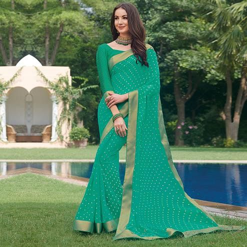 Jazzy Aqua Green Colored Partywear Foil Printed Georgette Saree