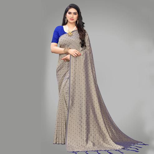 Jazzy Grey Colored Party Wear Printed Silk Blend Saree With Tassels