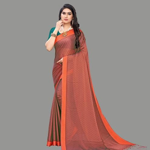 Lovely Brown Colored Party Wear Printed Poly Georgette Saree With Tassels