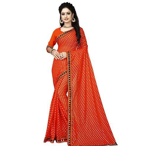 Charming Orange Colored Party Wear Foil Print Lycra Blend Saree