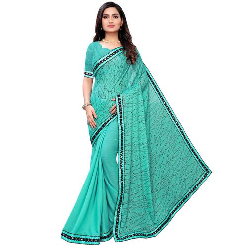 Flamboyant Rama Green Colored Party Wear Printed Lycra Blend Saree