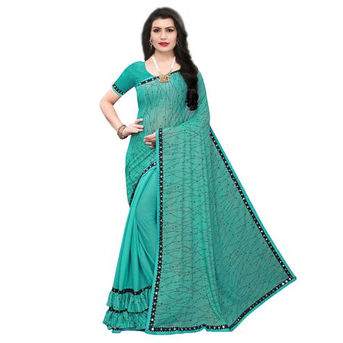 Stunning Rama Green Colored Party Wear Printed Lycra Blend Saree