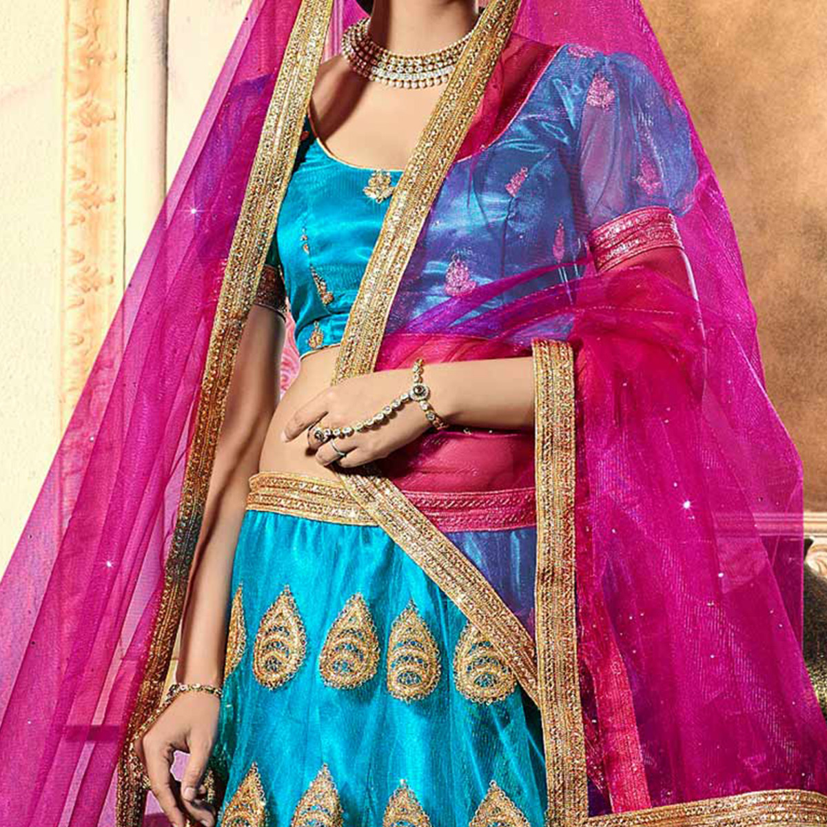 Charming Blue-Pink Designer Net Embroidered Lehenga Choli