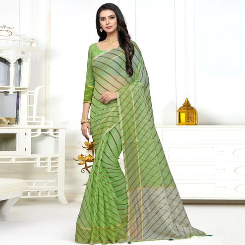 Demanding Green Colored Casual Wear Stripe Printed Kota Doria Saree With Tassels