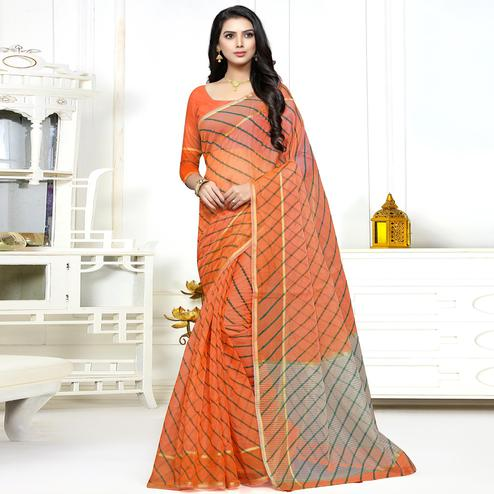 Unique Orange Colored Casual Wear Stripe Printed Kota Doria Saree With Tassels