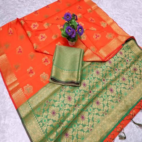 Captivating Orange Colored Festive Wear Printed Banarasi Silk Saree With Tassels