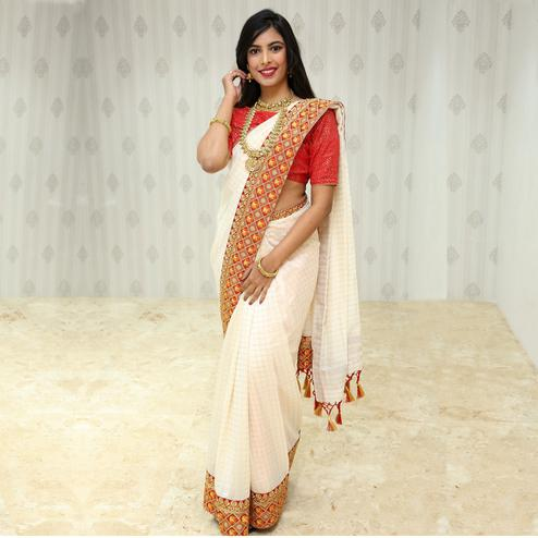 Ravishing White Colored Party Wear Embroidered Cotton Saree With Tassels