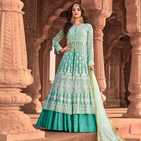 Intricate Light Green Colored Partywear Embroidered Pure Viscose Georgette Lehenga Suit