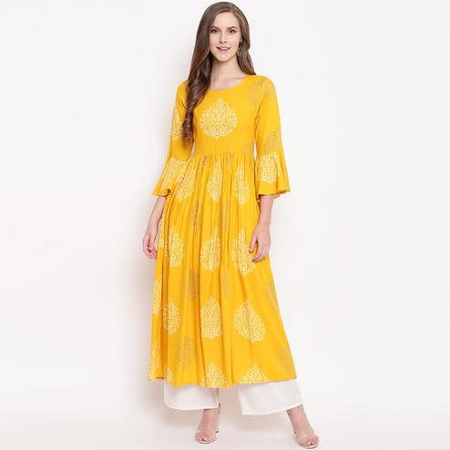 Appealing Yellow Colored Casual Wear Printed Rayon Kurti