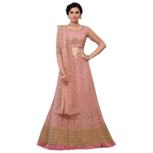 Hypnotic Pink Colored Party Wear Floral Embroidered Net Lehenga Choli