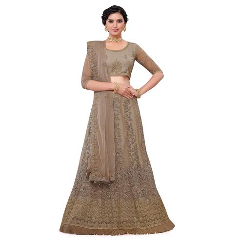 Marvellous Beige Colored Party Wear Floral Embroidered Net Lehenga Choli