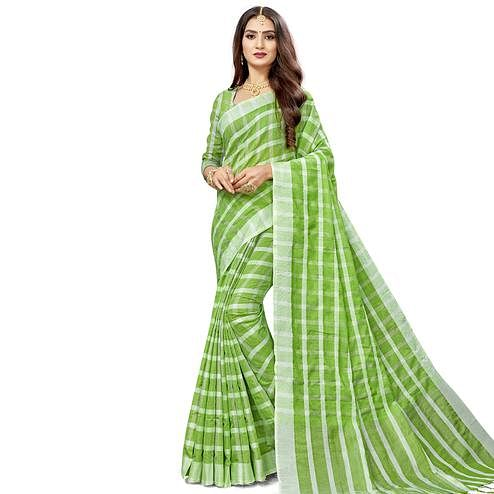 Flaunt Green Colored Fesive Wear Checks Print Cotton Silk Saree With Tassels