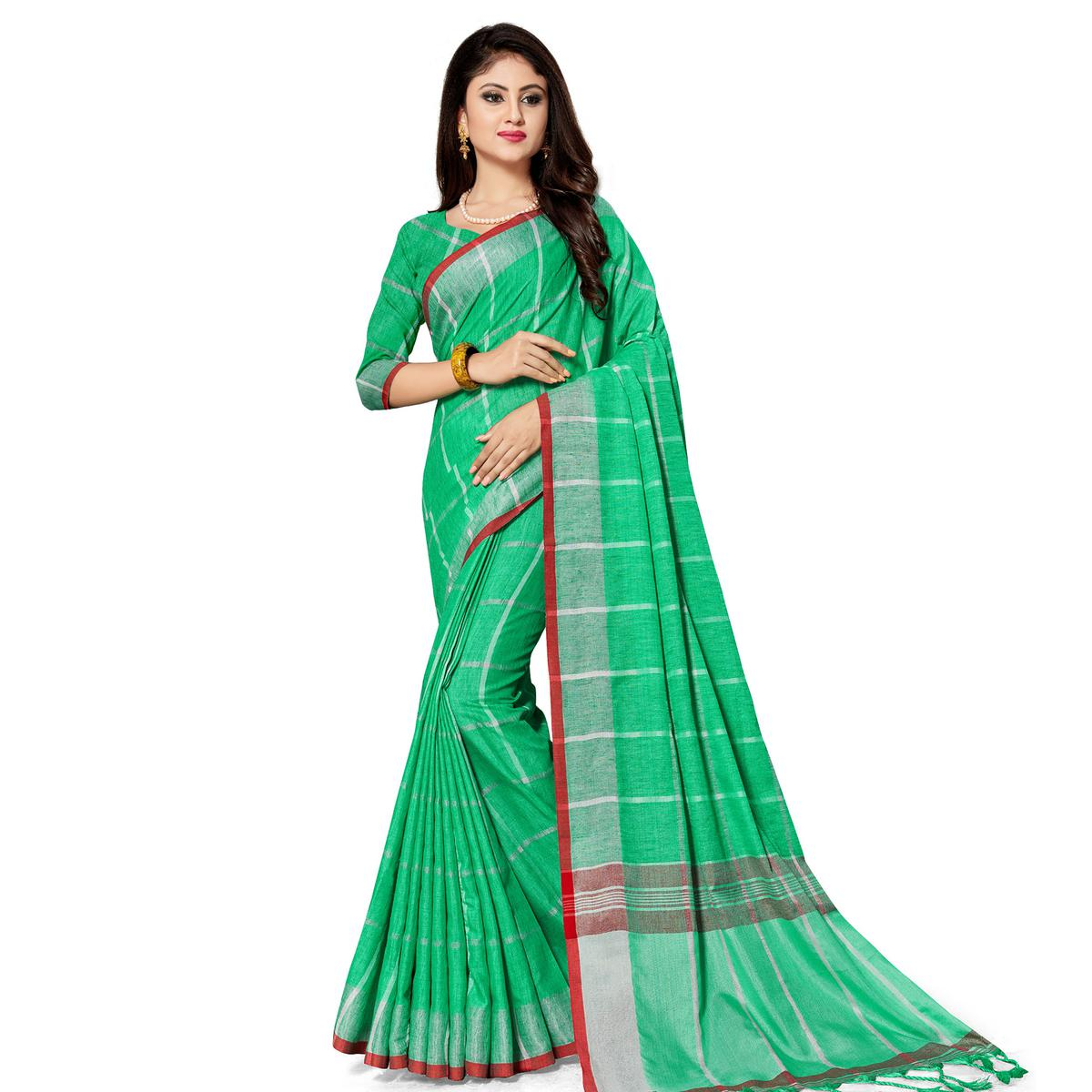 Alluring Green Colored Fesive Wear Stripe Print Cotton Silk Saree With Tassels