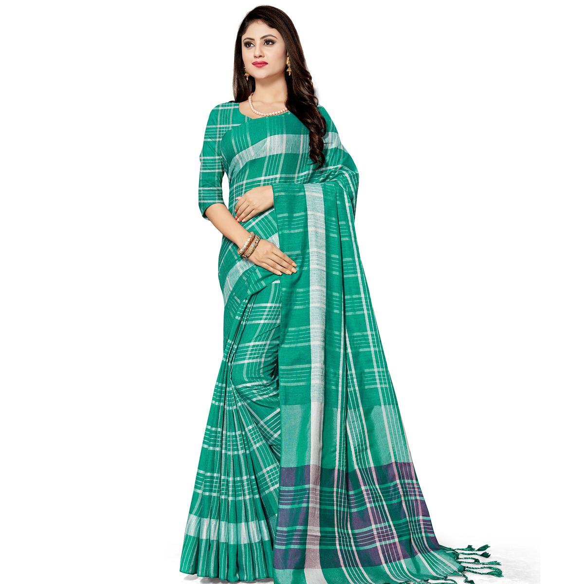 Adorning Green Colored Fesive Wear Stripe Print Cotton Silk Saree With Tassels