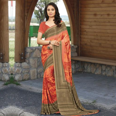 Marvellous Orange Colored Casual Wear Printed Crepe Saree