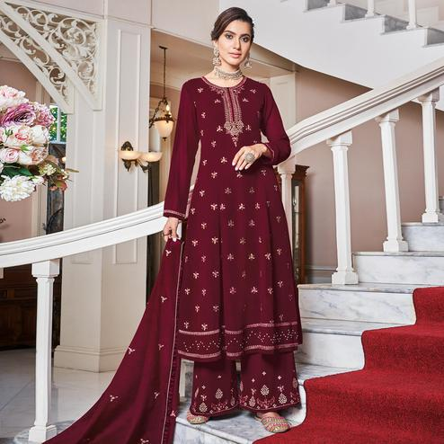 Lovely Maroon Colored Partywear Embroidered Heavy Georgette Palazzo Suit