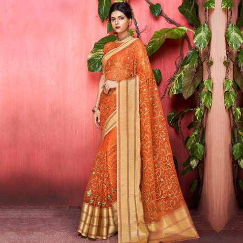 Entrancing Orange Colored Party Wear Floral Embroidered Organza Saree