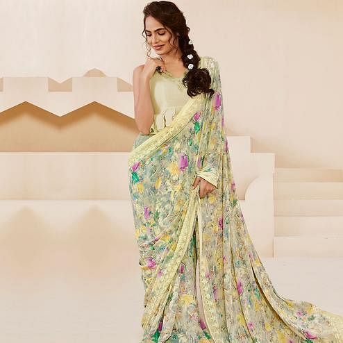 Exotic Light Yellow Colored Casual Wear Floral Printed Georgette Saree