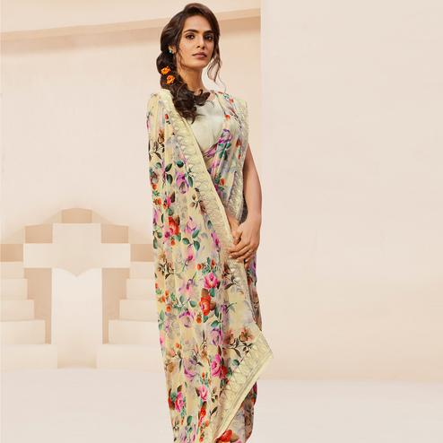 Gleaming Cream Colored Casual Wear Floral Printed Georgette Saree