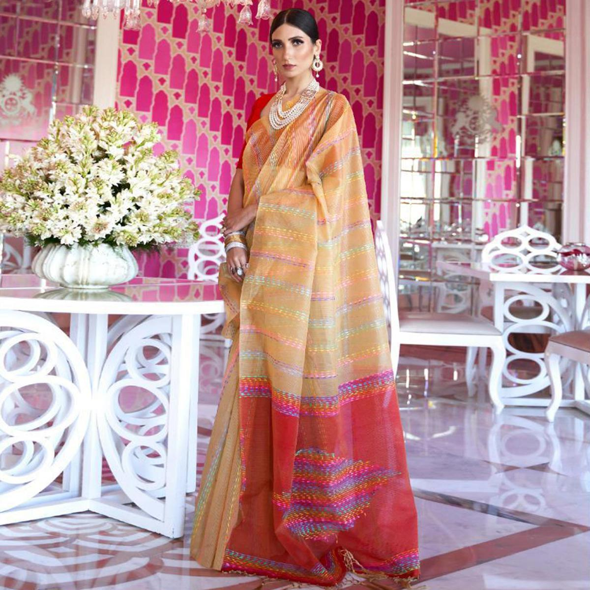 Engrossing Beige Colored Party Wear Embroidered Silk Saree With Tassels