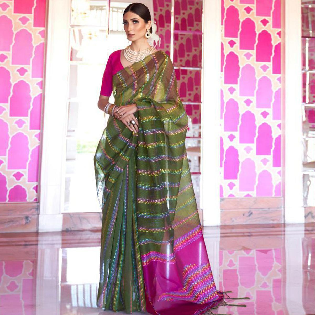 Eye-catching Green Colored Party Wear Embroidered Silk Saree With Tassels