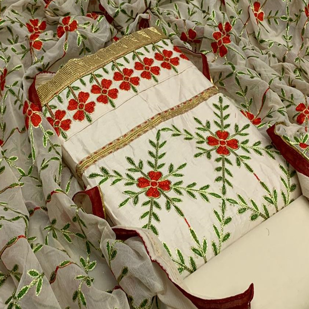 Ravishing Cream Colored Partywear Embroidered Cotton Dress Material
