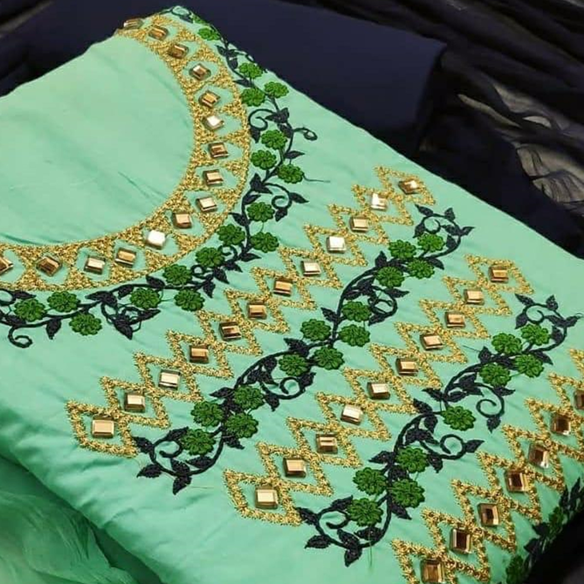 Prominent Turquoise Green Colored Partywear Embroidered Cotton Dress Material