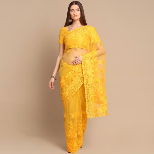 Glorious Yellow Colored Partywear Embroidered Net Saree