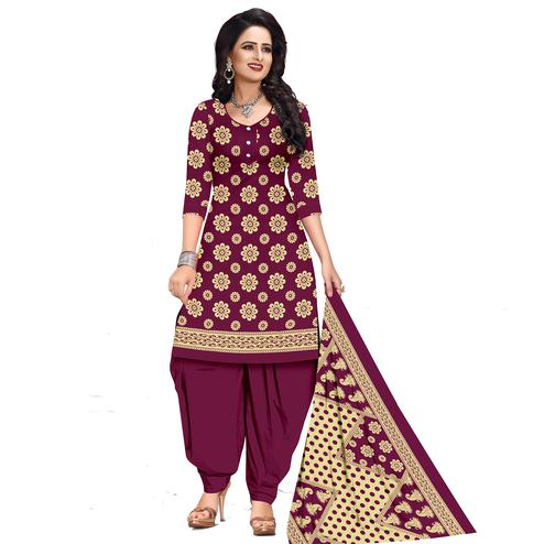 Mesmeric Wine Colored Casual Wear Printed Cotton Dress Material