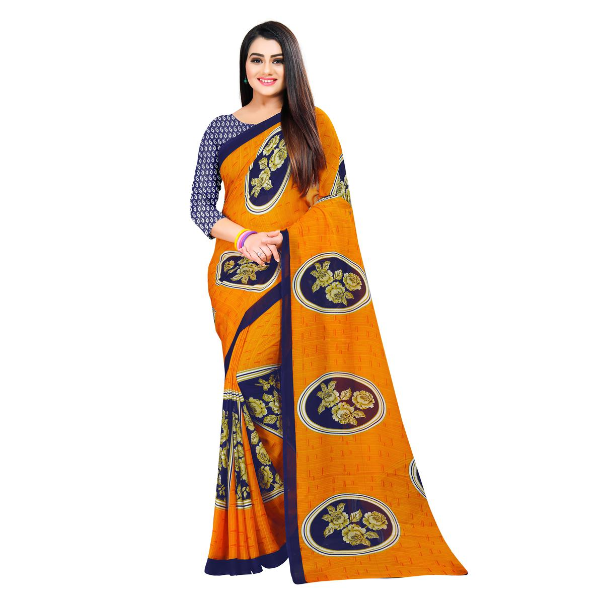 Captivating Orange Colored Casual Wear Printed Georgette Saree