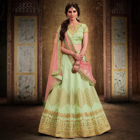 NAKKASHI - Opulent Pista Green Colored Party Wear Embroidered Handloom Raw Silk Lehenga Choli