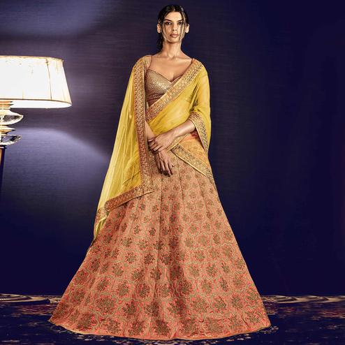 NAKKASHI - Charming Peach Colored Party Wear Embroidered Raw Silk Lehenga Choli