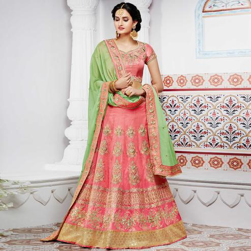 NAKKASHI - Marvellous Peach Colored Party Wear Embroidered Handloom Raw Silk Lehenga Choli