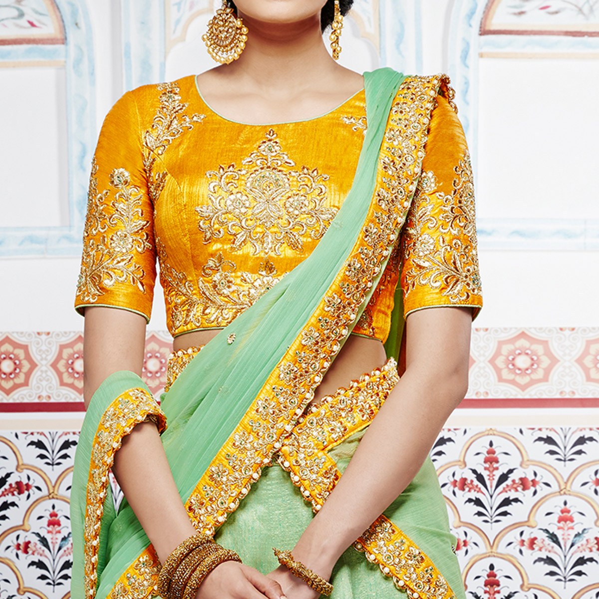 NAKKASHI - Pretty Pista Green Colored Party Wear Embroidered Handloom Raw Silk Lehenga Choli