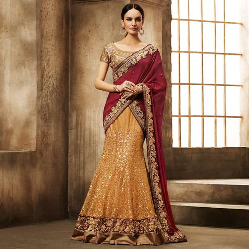 NAKKASHI - Demanding Mustard Yellow Colored Party Wear Embroidered Net Lehenga Choli