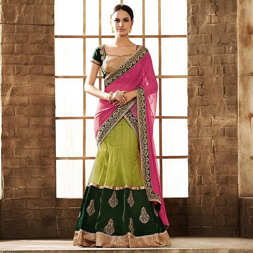 NAKKASHI - Magnetic Green Colored Party Wear Embroidered Net Lehenga Choli