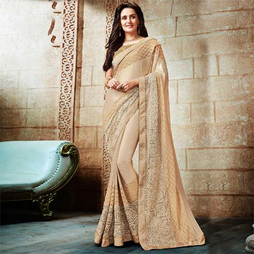 Spectacular Cream Embroidered Designer Partywear Saree
