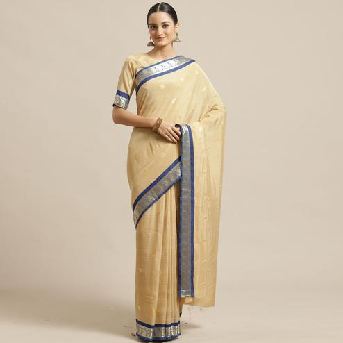 Exotic Beige Colored Festive Wear Woven Poly Georgette Saree