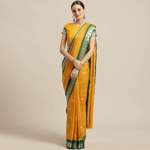 Elegant Mustard Colored Festive Wear Woven Poly Georgette Saree
